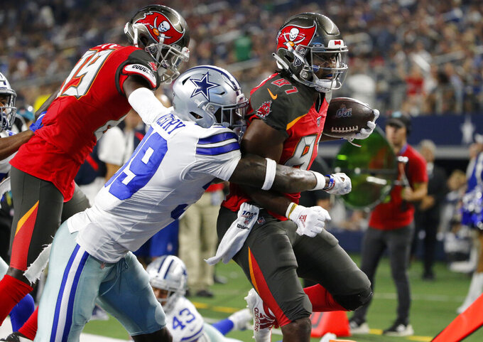 Dallas Cowboys cornerback Chris Westry (39) stops Tampa Bay Buccaneers wide receiver Anthony Johnson (81) in the second half of a preseason NFL football game in Arlington, Texas, Thursday, Aug. 29, 2019. (AP Photo/Michael Ainsworth)