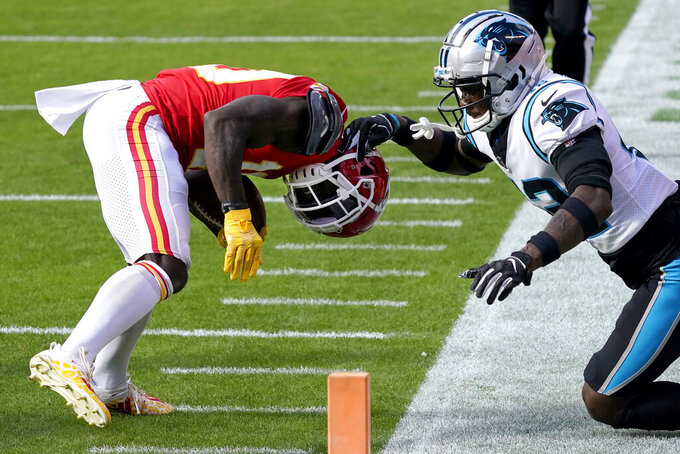 Kansas City Chiefs wide receiver Tyreek Hill, left, is tackled by Carolina Panthers safety Sam Franklin during the first half of an NFL football game in Kansas City, Mo., Sunday, Nov. 8, 2020. (AP Photo/Jeff Roberson)