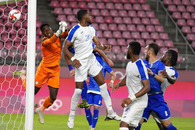 Honduras's Elvin Oliva, 21, scores an own goal during a men's soccer match against Romania at the 2020 Summer Olympics, Thursday, July 22, 2021, in Kashima, Japan. (AP Photo/Fernando Vergara)