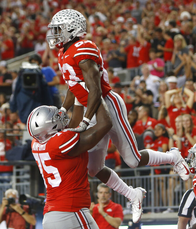 Ohio State receiver Terry McLaurin, top, celebrates his touchdown against Indiana with teammate Thayer Munford during the second half of an NCAA college football game Saturday, Oct. 6, 2018, in Columbus, Ohio. (AP Photo/Jay LaPrete)