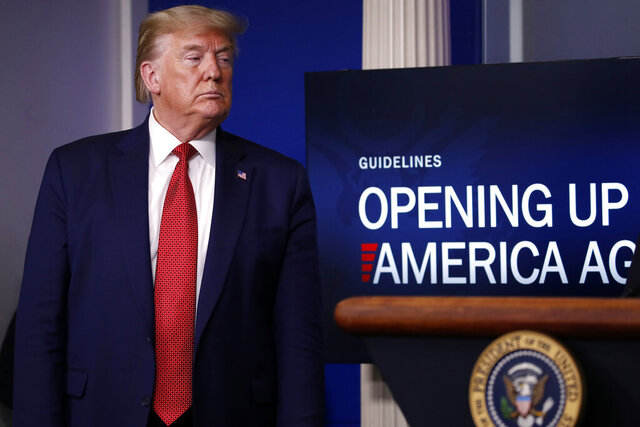 President Donald Trump listens during a briefing about the coronavirus in the James Brady Press Briefing Room of the White House, Thursday, April 16, 2020, in Washington. (AP Photo/Alex Brandon)