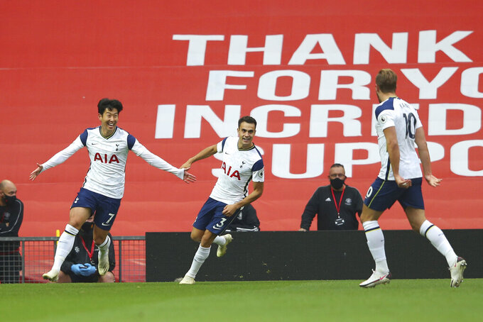 Tottenham's Son Heung-min, left, celebrates after scoring his side's second goal during the English Premier League soccer match between Manchester United and Tottenham Hotspur at Old Trafford in Manchester, England, Sunday, Oct. 4, 2020. (Alex Livesey/Pool via AP)