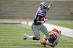 Bowling Green linebacker Brandon Perce (1) tackles Kansas State running back Jacardia Wright (28) during the first half of an NCAA college football game Saturday, Sept. 7, 2019, in Manhattan, Kan. (AP Photo/Charlie Riedel)