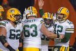 Green Bay Packers' Aaron Jones is congratulated by Aaron Rodgers and Corey Linsley after riunning for a touchdown during the second half of an NFL football game against the Chicago Bears Sunday, Jan. 3, 2021, in Chicago. (AP Photo/Nam Y. Huh)
