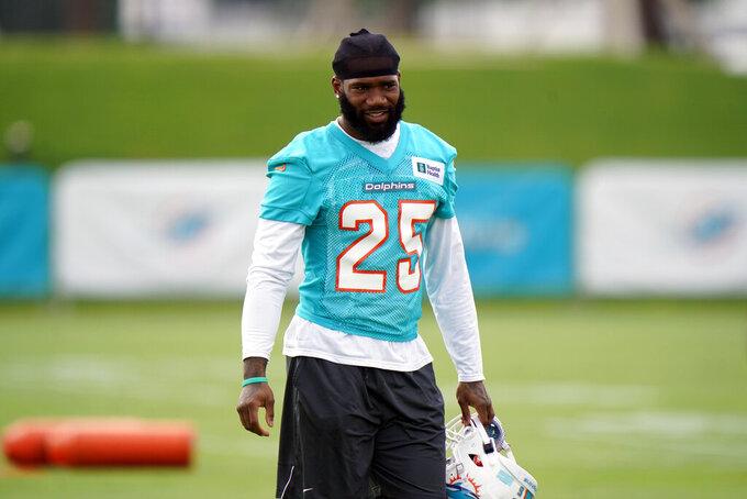Miami Dolphins cornerback Xavien Howard prepares to warm up during NFL football practice, Wednesday, July 28, 2021, in Miami Gardens, Fla. (AP Photo/Wilfredo Lee)