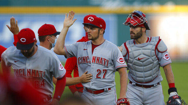 Cincinnati Reds pitcher Trevor Bauer (27) celebrates after the final out of the second baseball game of a doubleheader against the Detroit Tigers in Detroit, Sunday, Aug. 2, 2020. Cincinnati won 4-0. (AP Photo/Paul Sancya)