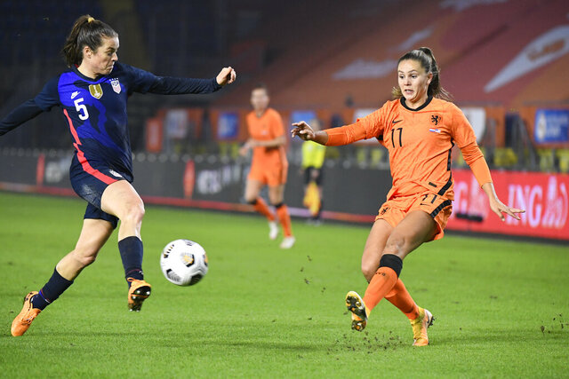 United States' Kelley O'Hara, left, tries to block a shot by Netherlands' Lieke Martens, right, during the international friendly women's soccer match between The Netherlands and the US at the Rat Verlegh stadium in Breda, southern Netherlands, Friday Nov. 27, 2020. (Piroschka van de Wouw/Pool via AP)