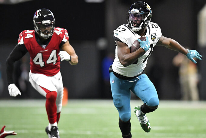 Jacksonville Jaguars running back Leonard Fournette (27) runs against the Atlanta Falcons during the first half of an NFL football game, Sunday, Dec. 22, 2019, in Atlanta. (AP Photo/Danny Karnik)