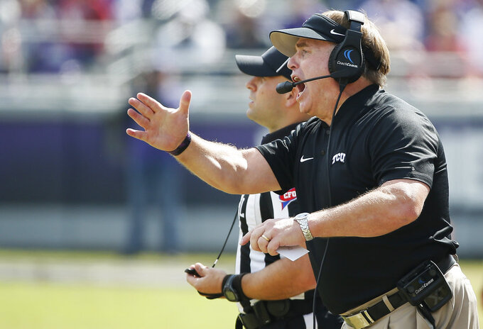 TCU head coach Gary Patterson shouts instructions to his players during the second half of an NCAA college football game against Oklahoma, Saturday, Oct. 20, 2018, in Fort Worth, Texas. Oklahoma won 52-27. (AP Photo/Brandon Wade)