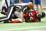 Referee Terry McAulay (77) breaks up an altercation between Atlanta Falcons running back Devonta Freeman (24) and Los Angeles Rams defensive tackle Aaron Donald during the second half of an NFL football game, Sunday, Oct. 20, 2019, in Atlanta. (AP Photo/John Amis)