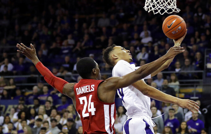 Washington forward Dominic Green, right, puts up a shot against Washington State guard Viont'e Daniels (24) during the first half of an NCAA college basketball game, Saturday, Jan. 5, 2019, in Seattle. (AP Photo/Ted S. Warren)