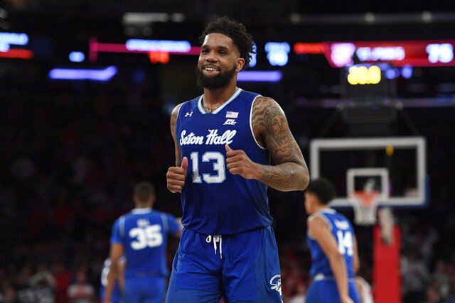 Seton Hall guard Myles Powell (13) reacts after making a basket during the second half of an NCAA  college basketball game against St. John's in New York, Saturday, Jan. 18, 2020. Seton Hall won 82-79. (AP Photo/Sarah Stier)
