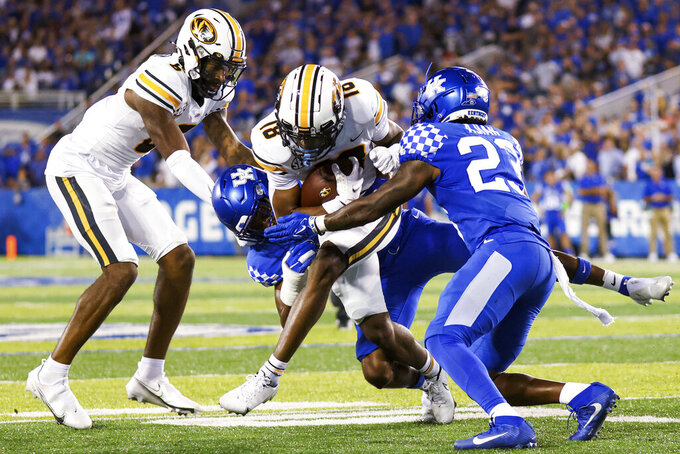 Missouri wide receiver Chance Luper (18) is tackled during the second half of the team's NCAA college football game against Kentucky in Lexington, Ky., Saturday, Sept. 11, 2021. (AP Photo/Michael Clubb)