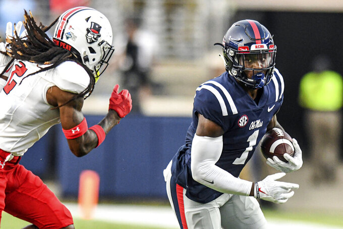 Mississippi wide receiver Jonathan Mingo (1) catches a pass against Austin Peay safety Johnathon Edwards (2) during an NCAA college football game in Oxford, Miss., Saturday, Sept. 11, 2021. (AP Photo/Bruce Newman)