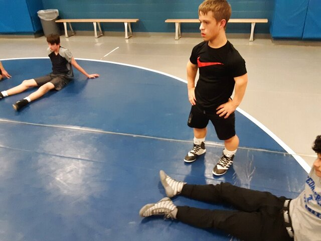 Despite being born with dwarfism, a condition that prevents him from ever growing taller than 4 feet, 8 inches, Cedar Crest junior Bailey Pennypacker is a key member of the school's wrestling team. (Pat Huggins/Lebanon Daily News via AP)