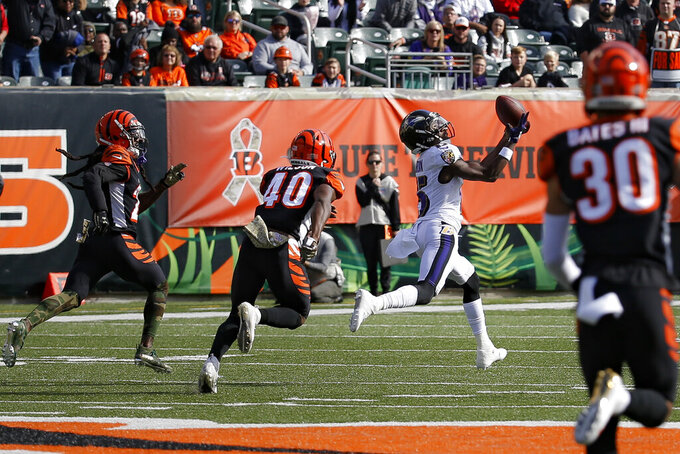 Baltimore Ravens wide receiver Marquise Brown (15) catches a pass against Cincinnati Bengals defensive back Brandon Wilson (40) during the first half of NFL football game, Sunday, Nov. 10, 2019, in Cincinnati. (AP Photo/Frank Victores)