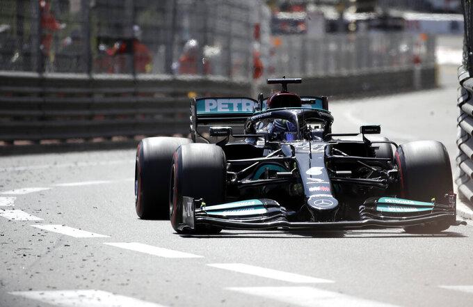 Mercedes driver Lewis Hamilton of Britain steers his car during the Monaco Grand Prix at the Monaco racetrack, in Monaco, Sunday, May 23, 2021. (AP Photo/Luca Bruno)