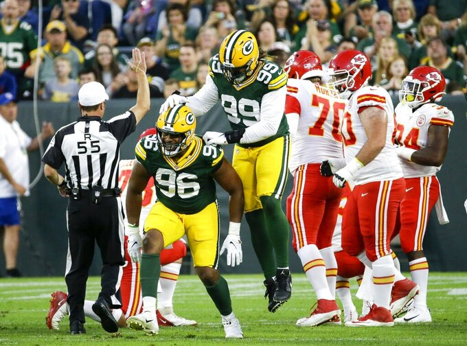 Green Bay Packers' Kingsley Keke celebrates his sack of Kansas City Chiefs quarterback Kyle Shurmur during the first half of a preseason NFL football game Thursday, Aug. 29, 2019, in Green Bay, Wis. (AP Photo/Mike Roemer)
