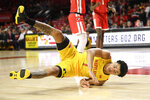 Maryland guard Anthony Cowan Jr. (1) falls to the floor during the first half of an NCAA college basketball game against Fairfield, Tuesday, Nov. 19, 2019, in College Park, Md. (AP Photo/Nick Wass)