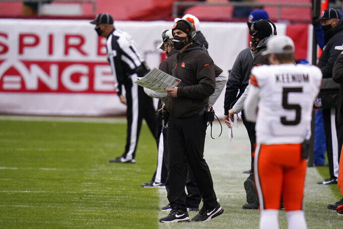 Cleveland Browns head coach Kevin Stefanski, center, watches from the sideline during the second half of an NFL divisional round football game against the Kansas City Chiefs, Sunday, Jan. 17, 2021, in Kansas City. (AP Photo/Jeff Roberson)