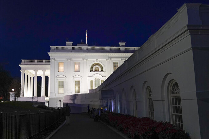 The White House is illuminated after dark Thursday, Jan. 7, 2021, in Washington. (AP Photo/Patrick Semansky)