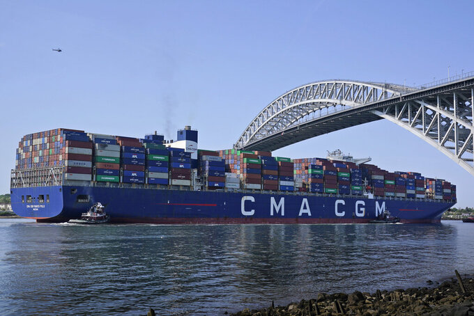 The CMA CGM Marco Polo passes underneath the Bayonne Bridge on its way to the Elizabeth-Port Authority Marine Terminal as seen from Bayonne, N.J., Thursday, May 20, 2021. When the CMA CGM Marco Polo docks in New Jersey Thursday it will set a record for the largest container ship ever to visit the East Coast, a reflection both of the New York/New Jersey port system's multibillion-dollar efforts to accommodate larger ships and of the surging demand nationwide for products as COVID-19 restrictions continue to ease. (AP Photo/Seth Wenig)