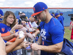 New York Mets' Tim Tebow signs autographs at spring training baseball practice Saturday, Feb. 16, 2019, in Port St. Lucie, Fla. (AP Photo/Mike Fitzpatrick)
