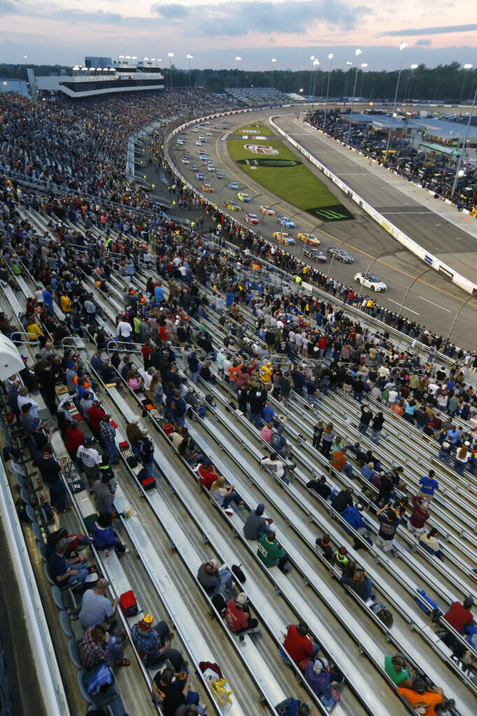 Fans wait for the start of the NASCAR Cup Series auto race at Richmond Raceway in Richmond, Va., Saturday, April 13, 2019. (AP Photo/Steve Helber)