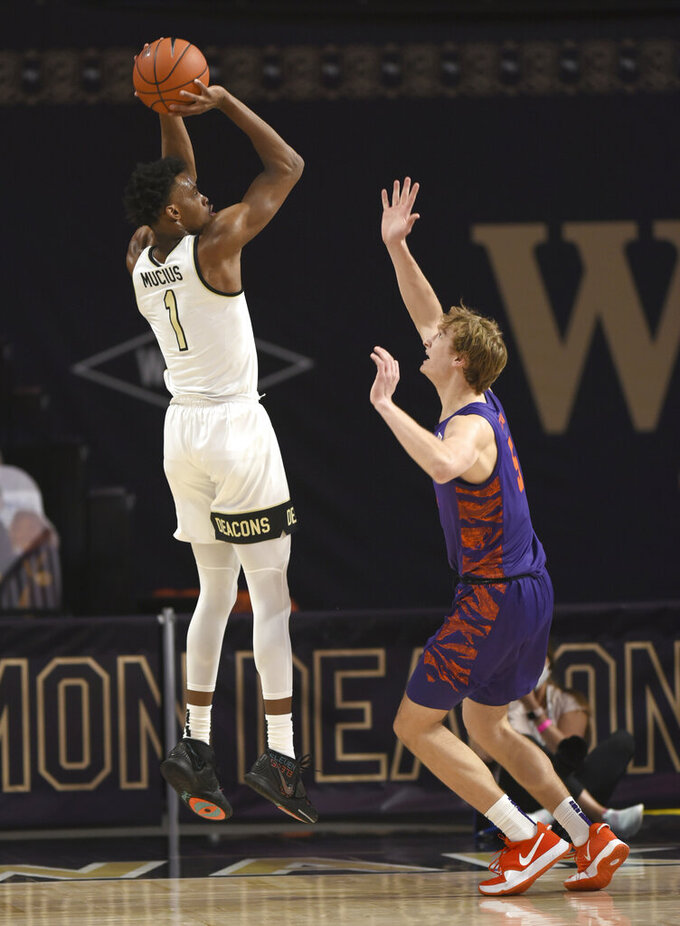 Wake Forest's Isaiah Mucius (1) shoots over Clemson's Hunter Tysonduring the first half of an NCAA college basketball game, Wednesday, Feb. 24, 2021 at Joel Coliseum in Winston-Salem, N.C. (Walt Unks/The Winston-Salem Journal via AP, Pool)