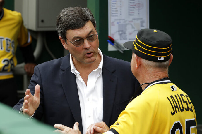 Pittsburgh Pirates chairman Robert Nutting, left, talks with Pirates coach Dave Jauss in the dugout after the firing of manager Clint Hurdle before the final baseball game of the season against the Cincinnati Reds in Pittsburgh, Sunday, Sept. 29, 2019. (AP Photo/Gene J. Puskar)