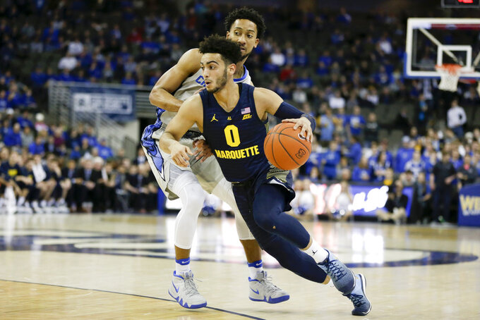 Marquette's Markus Howard (0) tries to get past Creighton's Davion Mintz during the first half of an NCAA college basketball game in Omaha, Neb., Wednesday, Jan. 9, 2019. (AP Photo/Nati Harnik)