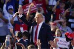 President Donald Trump waves to the crowd after speaking at a campaign rally at Phoenix Goodyear Airport Wednesday, Oct. 28, 2020, in Goodyear, Ariz. (AP Photo/Ross D. Franklin)