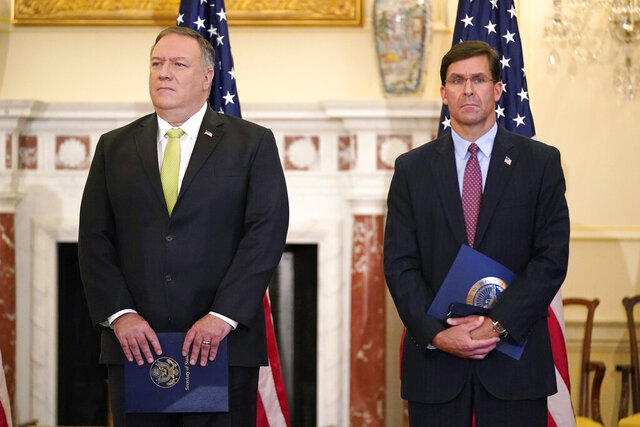 FILE - In this Sept. 21, 2020, file photo Secretary of State Mike Pompeo, left, and Defense Secretary Mark Esper attend a news conference at the U.S. State Department in Washington. Just a week before November's election, Pompeo and Esper will visit India for meetings focused largely on countering China's growing global influence. (AP Photo/Patrick Semansky, File)