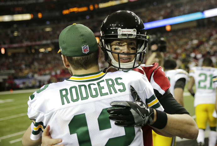 FILE - In this Jan. 22, 2017, file photo, Green Bay Packers' Aaron Rodgers hugs Atlanta Falcons' Matt Ryan before the NFL football NFC championship game, in Atlanta. The fortunes of the Atlanta Falcons and Green Bay Packers have changed less than two years after they met in the NFC title game. They're each trying to avoid losing records when the teams meet on Sunday at Lambeau Field. (AP Photo/David Goldman, File)
