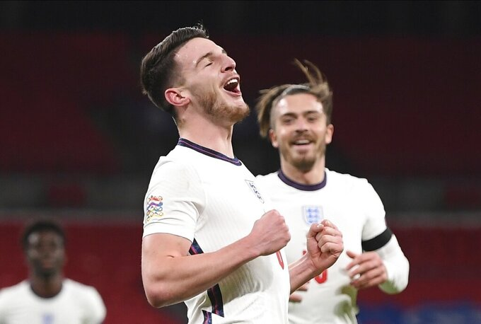 England's Declan Rice celebrates after scoring the opening goal during the UEFA Nations League soccer match between England and Iceland at Wembley stadium in London, Wednesday, Nov. 18, 2020. (Michael Regan/Pool via AP)