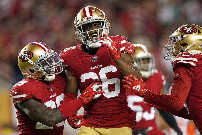 San Francisco 49ers' Marcell Harris, center, celebrates after forcing a fumble by Cleveland Browns' Odell Beckham Jr. on a punt return, which the 49ers recovered, during the second half of an NFL football game in Santa Clara, Calif., Monday, Oct. 7, 2019. (AP Photo/Tony Avelar)