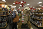 Customers shop at a Kohl's store in Colma, Calif., Friday, Nov. 29, 2019. Black Friday once again kicked off the start of the holiday shopping season. (AP Photo/Jeff Chiu)