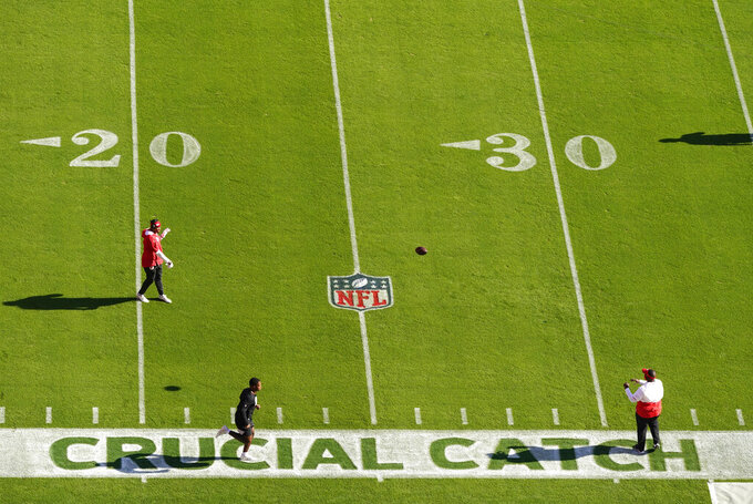 """Crucial Catch"" is seen on the field as players warm up before an NFL football game between the Kansas City Chiefs and the Las Vegas Raiders, Sunday, Oct. 11, 2020, in Kansas City. (AP Photo/Charlie Riedel)"