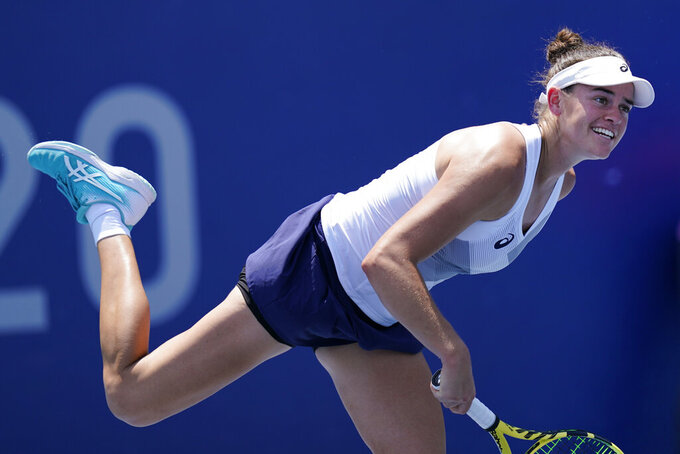 Jennifer Brady, of the United States, serves to Camila Giorgi, of Italy, during the tennis competition at the 2020 Summer Olympics, Sunday, July 25, 2021, in Tokyo, Japan. (AP Photo/Patrick Semansky)