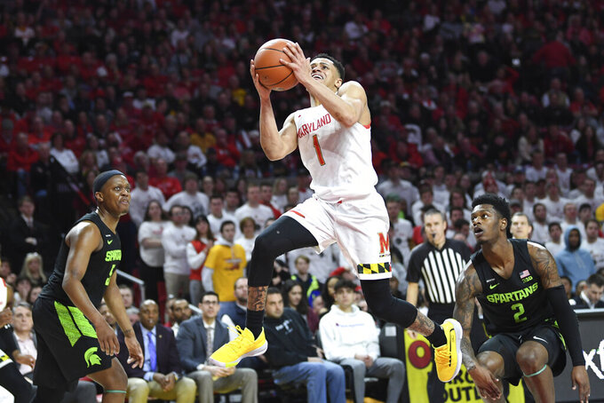 Maryland guard Anthony Cowan Jr. (1) goes to the basket for a layup during the second half of an NCAA college basketball game against Michigan State, Saturday, Feb. 29, 2020, in College Park, Md. (AP Photo/Terrance Williams)