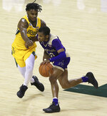 Alcorn State guard Byron Joshua (30) drives the ball against Baylor guard Davion Mitchell (45) in the first half of an NCAA college basketball game, Wednesday, Dec. 30, 2020, in Waco, Texas. (AP Photo/ Jerry Larson)