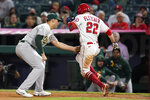 Los Angeles Angels' David Fletcher (22) is tagged out by Oakland Athletics first baseman Matt Olson during the seventh inning of a baseball game Friday, Sept. 17, 2021, in Anaheim, Calif. (AP Photo/Ashley Landis)