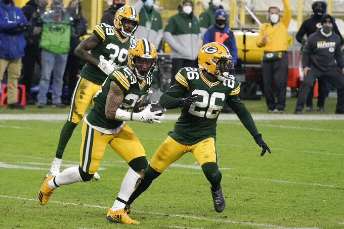 Green Bay Packers' Jaire Alexander (23) runs with the ball after intercepting a pass intended for Tampa Bay Buccaneers' Mike Evans during the second half of the NFC championship NFL football game in Green Bay, Wis., Sunday, Jan. 24, 2021. (AP Photo/Morry Gash)