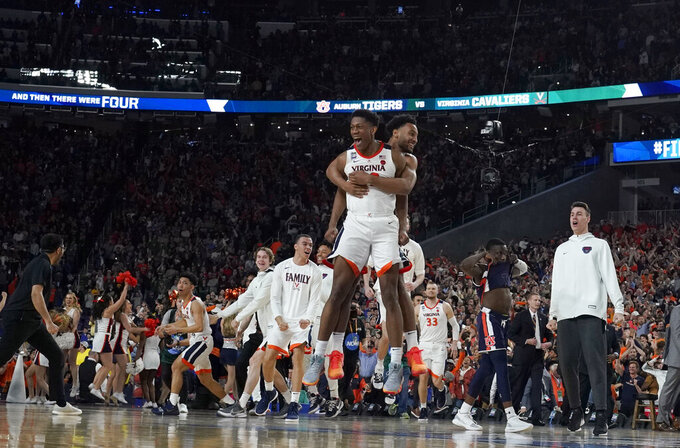 Virginia players celebrate after defeating Auburn 63-62 in the semifinals of the Final Four NCAA college basketball tournament, Saturday, April 6, 2019, in Minneapolis. (AP Photo/David J. Phillip)