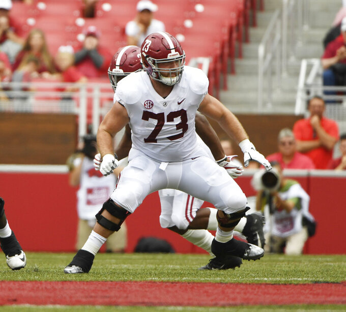 FILE - In this Oct. 6, 2018, file photo, Alabama offensive lineman Jonah Williams sets up to block against Arkansas in the second half of an NCAA college football game, in Fayetteville, Ark. Williams was named to The Associated Press Midseason All-America team, Tuesday, Oct. 16, 2018.(AP Photo/Michael Woods, File)