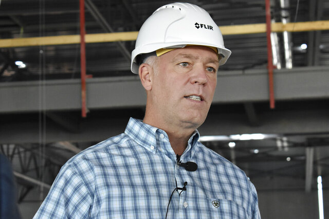 Montana U.S. Rep. and gubernatorial candidate Greg Gianforte speaks after touring a high tech manufacturing facility in Bozeman, Mont., Sept. 2, 2020. Gianforte, a Republican, and his Democratic opponent, Lt. Gov. Mike Cooney, both pledge to rely on the advice of public health professionals, but their approach to the virus has differed at every turn of the campaign. (AP Photo/Matthew Brown)