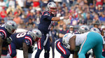 New England Patriots rookie quarterback Mac Jones (10) points on the line of scrimmage during the first half of an NFL football game against the Miami Dolphins, Sunday, Sept. 12, 2021, in Foxborough, Mass. (AP Photo/Steven Senne)
