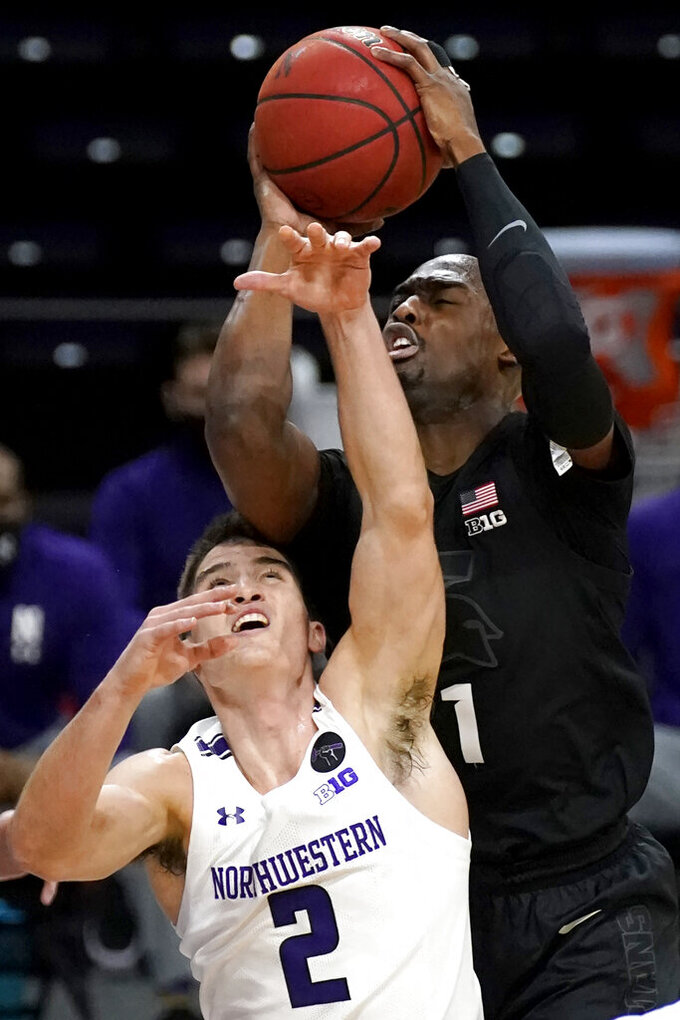 Michigan State guard Joshua Langford, right, rebounds the ball against Northwestern guard Ryan Greer during the first half of an NCAA college basketball game in Evanston, Ill., Sunday, Dec. 20, 2020. (AP Photo/Nam Y. Huh)