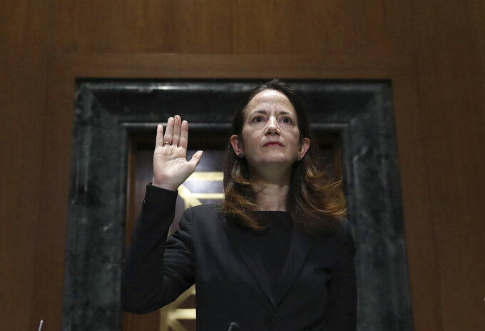 President-elect Joe Biden's pick for national intelligence director Avril Haines is sworn in during a confirmation hearing before the Senate intelligence committee on Tuesday, Jan. 19, 2021, in Washington. (Joe Raedle/Pool via AP)