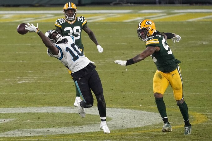 Carolina Panthers' Curtis Samuel can't catch a pass during the second half of an NFL football game against the Green Bay Packers Saturday, Dec. 19, 2020, in Green Bay, Wis. The Packers won 24-16. (AP Photo/Morry Gash)